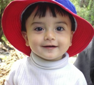 Child Smiles in a Hat